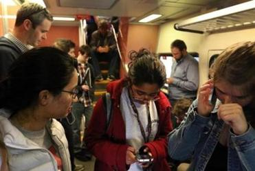 Boston University students Premsai Nagabhrava (left), Raji Pyda (middle), and Alanna Cote on a commuter rail train in Boston.